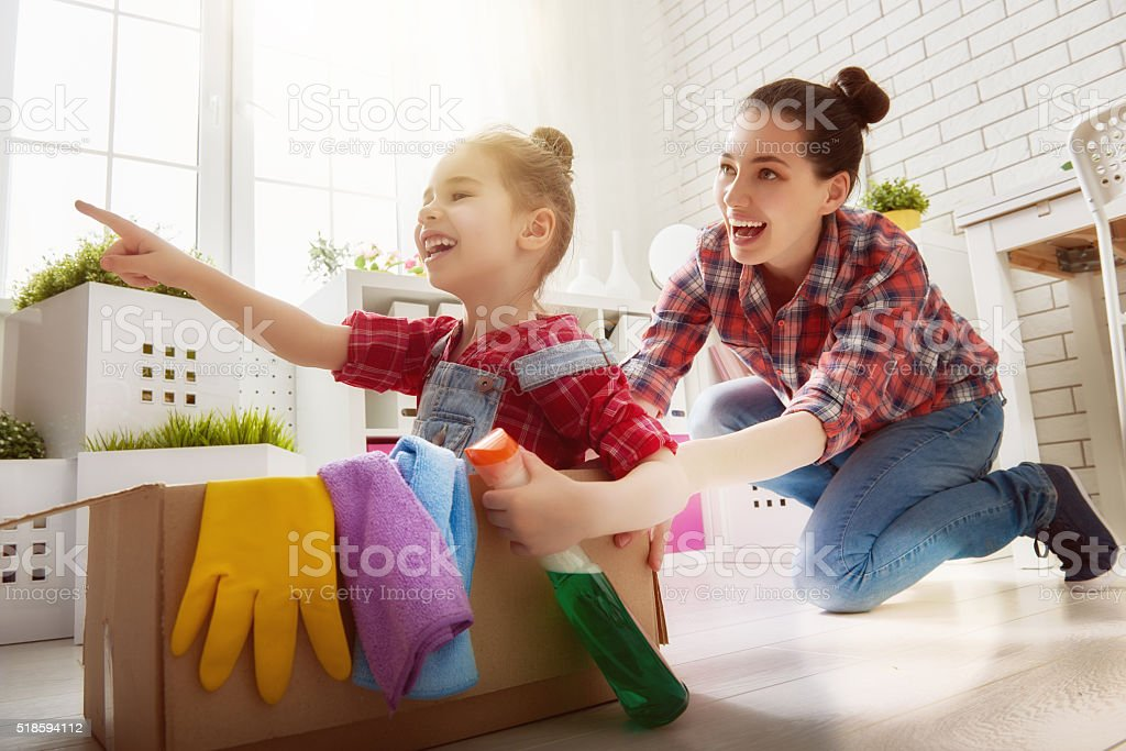 family cleans the room stock photo
