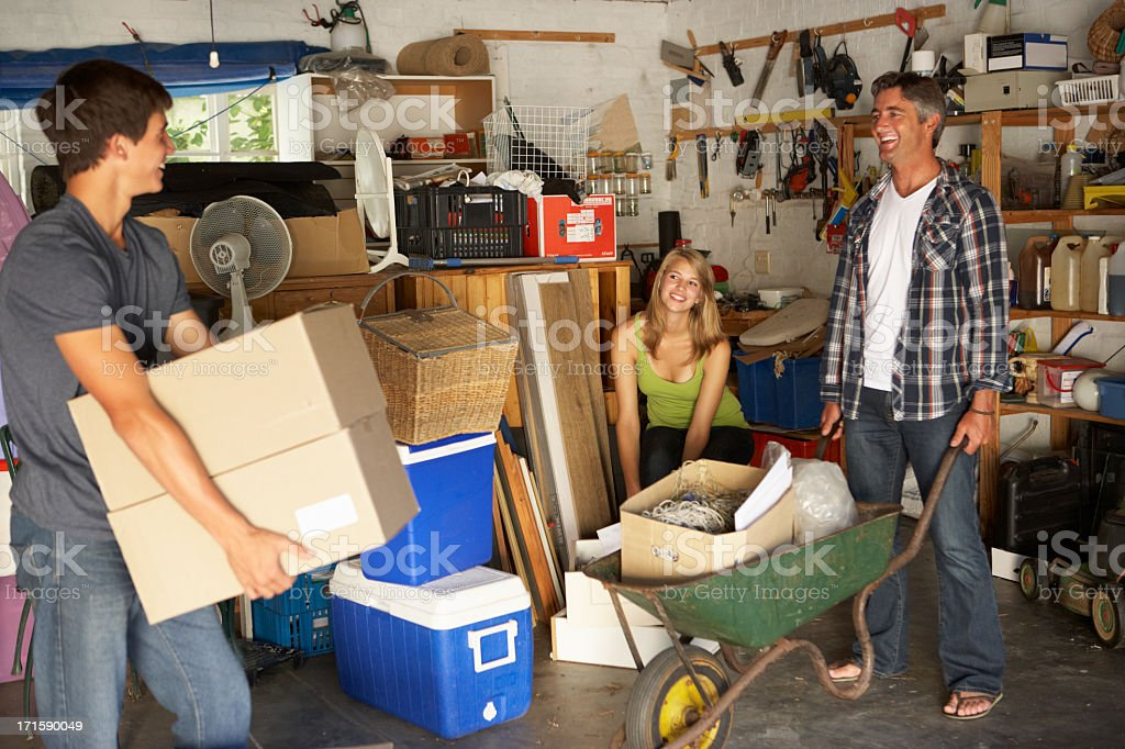 Family clearing out the garage for a yard sale stock photo