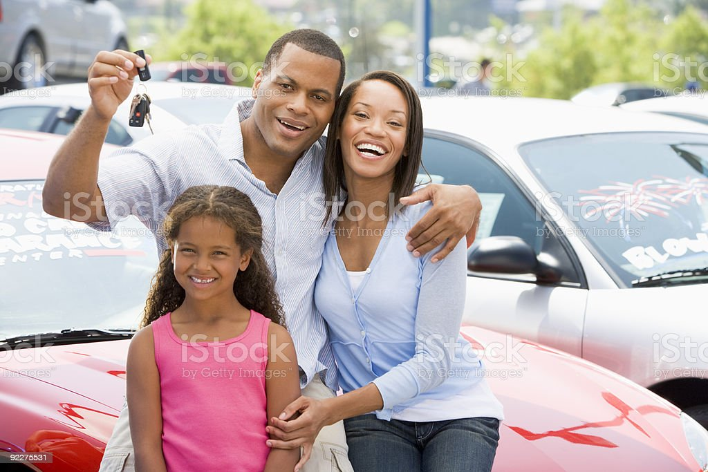 Family collecting new car stock photo