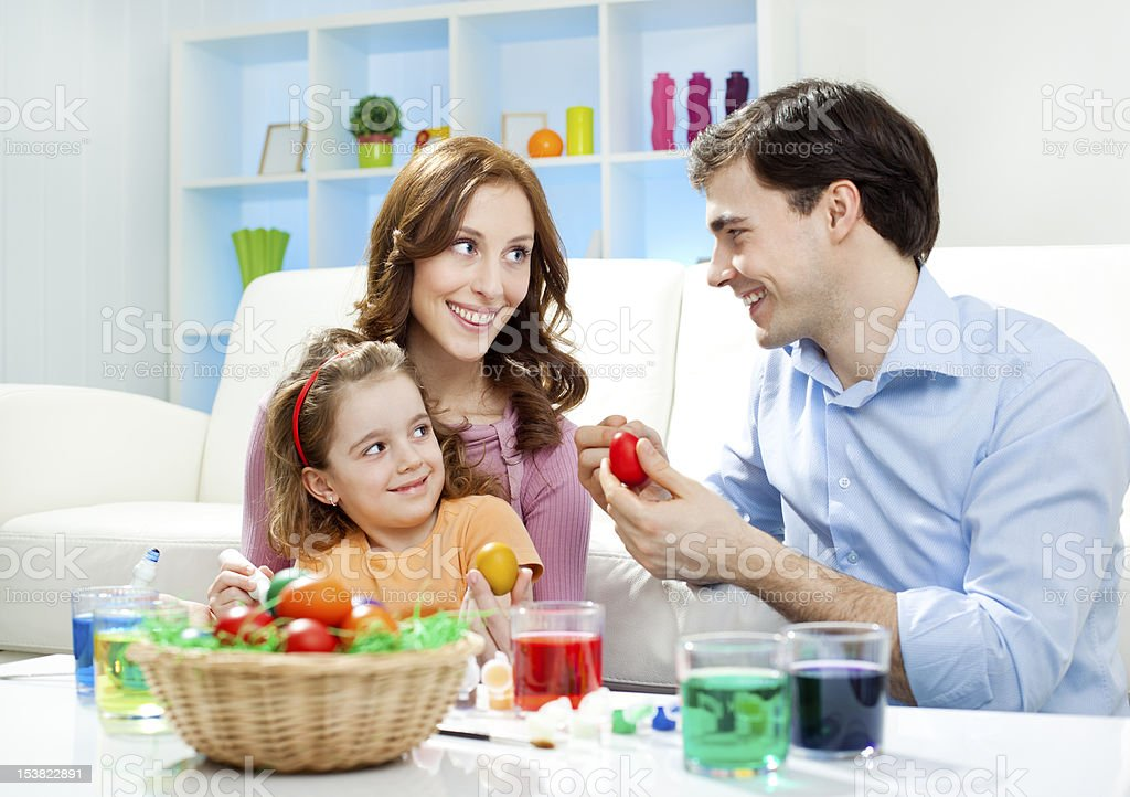 Family Coloring Easter Eggs royalty-free stock photo