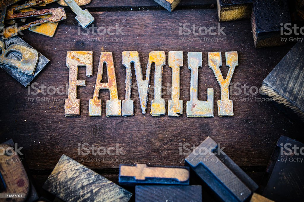 Family Concept Wood and Rusted Metal Letters stock photo