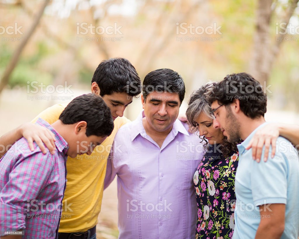 Family contemplating stock photo
