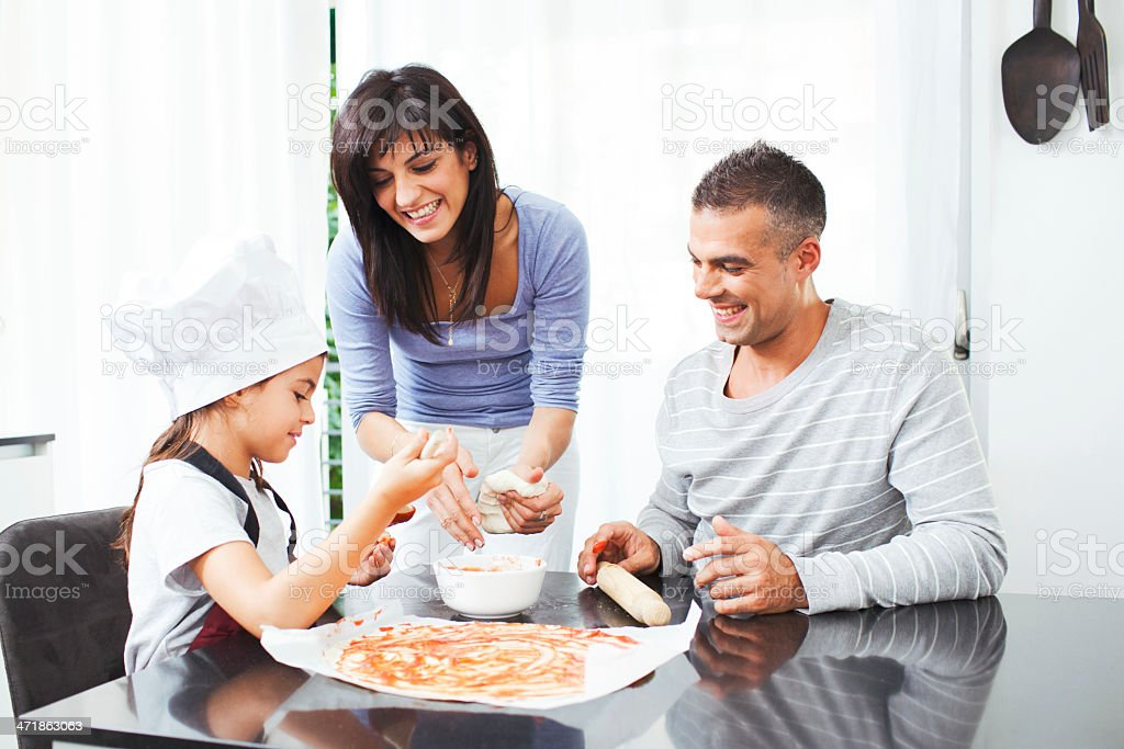 Family cooking and eating together Italina food. royalty-free stock photo