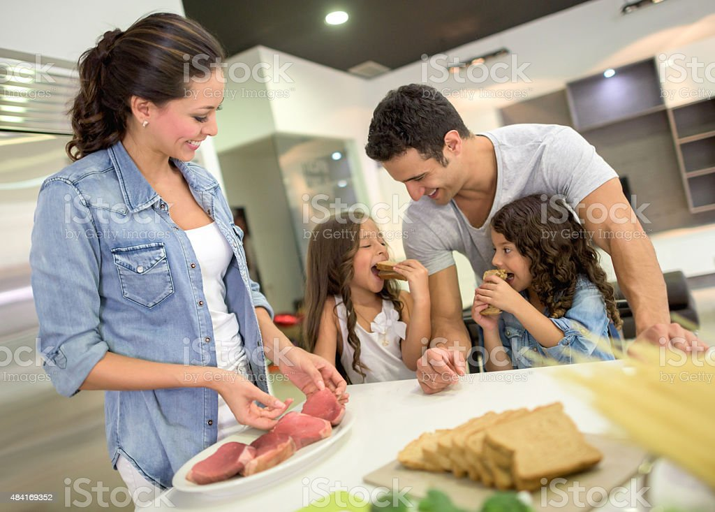 Family cooking dinner at home stock photo