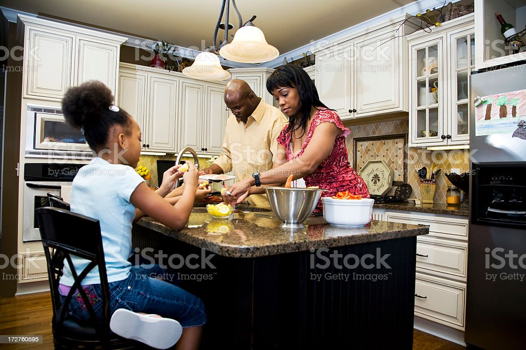 A family cooking in the kitchen royalty-free stock photo
