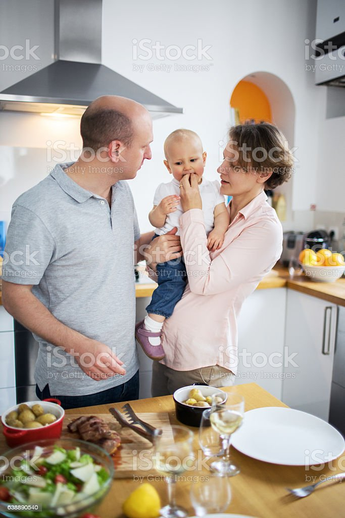 Family cooking lunch together at home stock photo