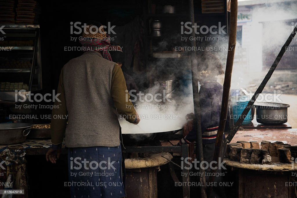 Family Cooking Meal Outdoors With Smoke In Their Faces stock photo