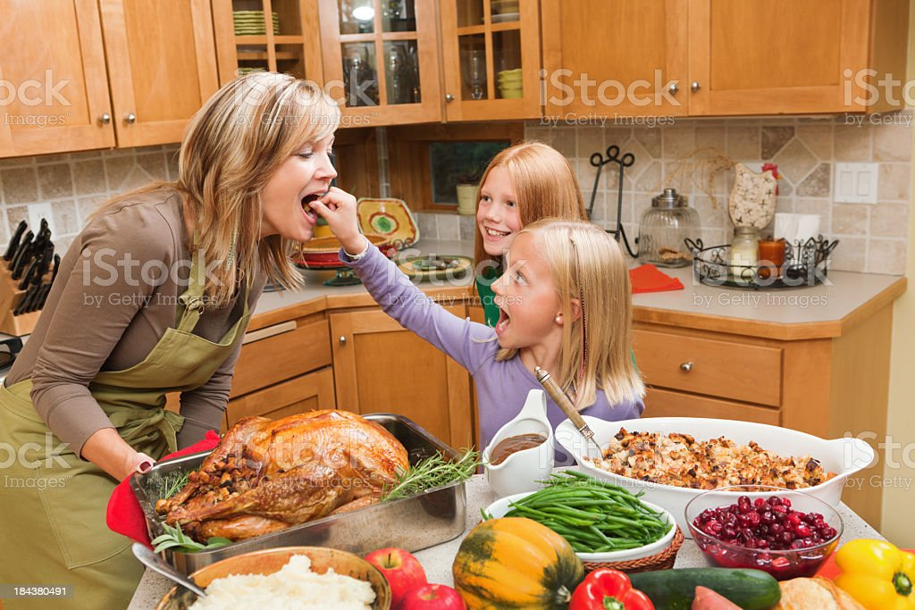 Family Cooking Thanksgiving Holiday Dinner  with Children in Kitchen royalty-free stock photo