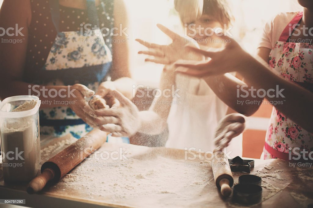 Family cooking together in the morning stock photo