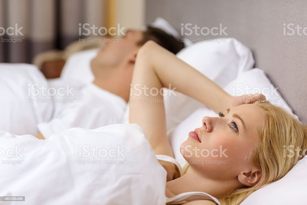 family couple in bed, woman with insomnia stock photo