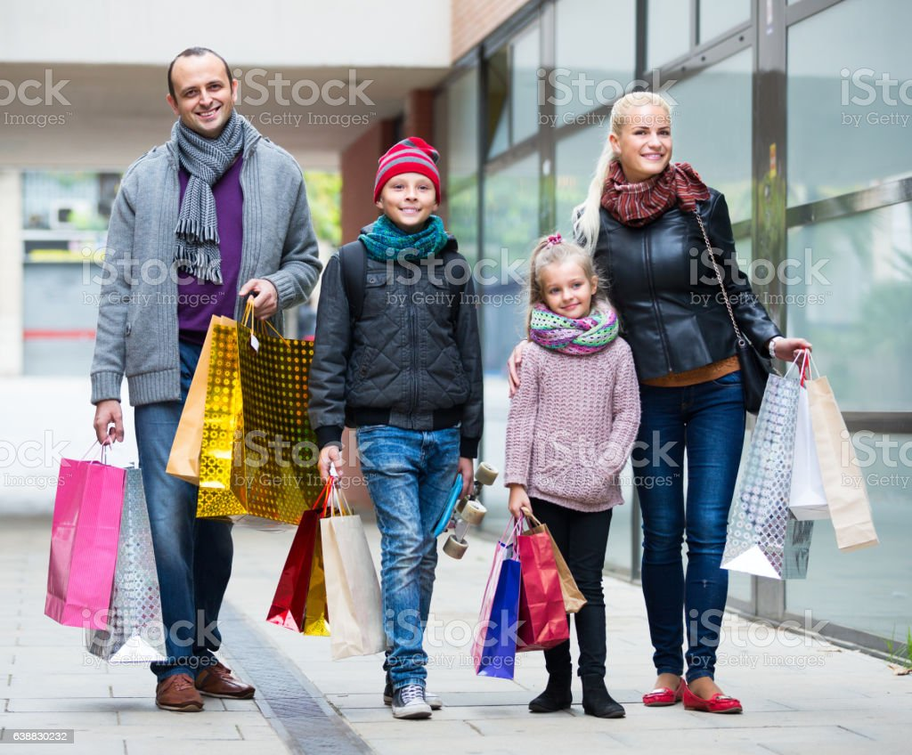 Family couple with kids  on city street stock photo