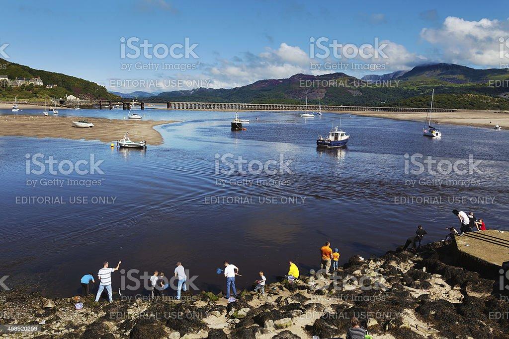 Family Crabbing at Barmouth, Wales stock photo