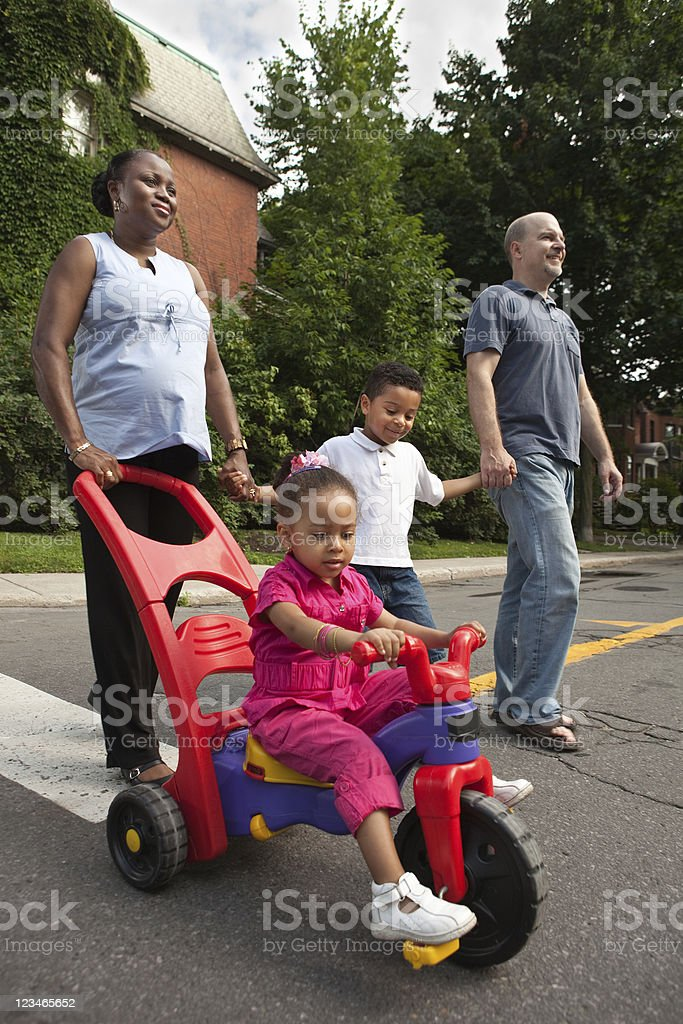 Family crossing the street royalty-free stock photo