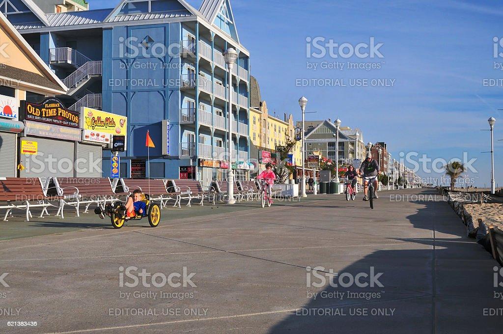 Family Cycling on Ocean City Boardwalk stock photo