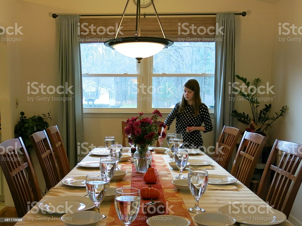 Family Daughter Setting the Thanksgiving Day Feast Table stock photo