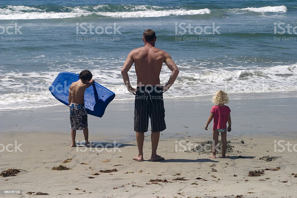 Family Day at Beach, Body-Board, Man, Two Children, Ocean, Summer royalty-free stock photo