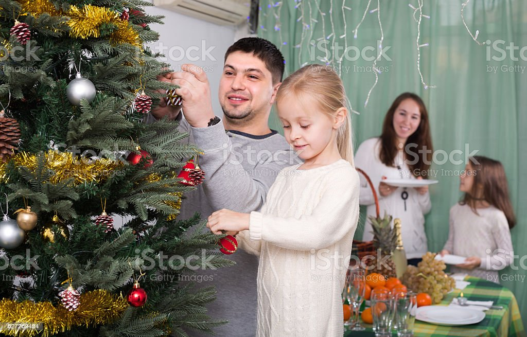 People Decorating For Christmas mother and daughter decorating christmas tree at home hz pictures