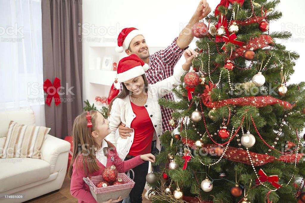 Family decorating christmas tree. royalty-free stock photo
