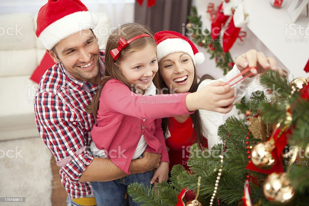 Family decorating christmas tree. royalty-free stock photo
