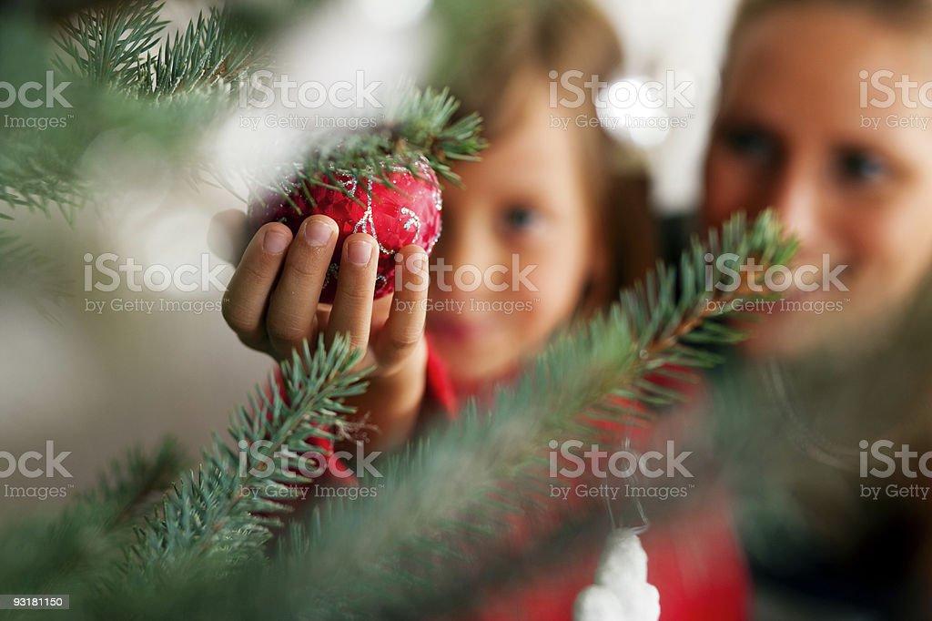 Family decorating Christmas tree stock photo