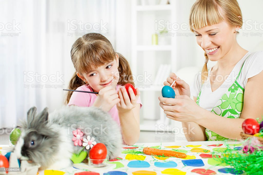Family Decorating Easter Eggs. royalty-free stock photo