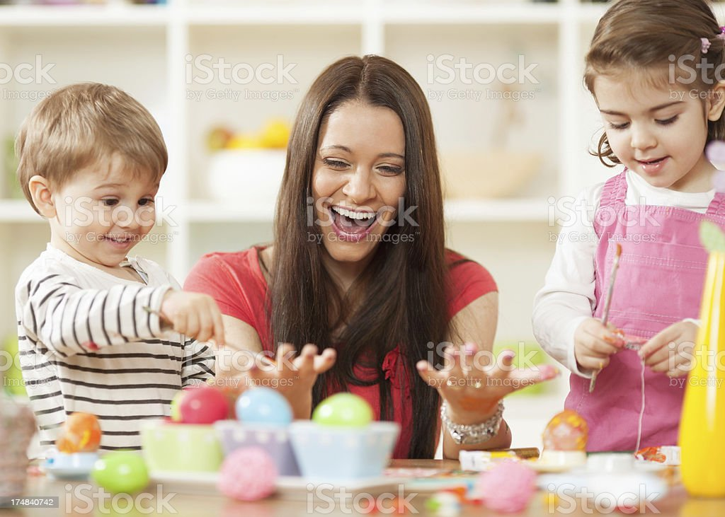 Family decorating Easter eggs royalty-free stock photo