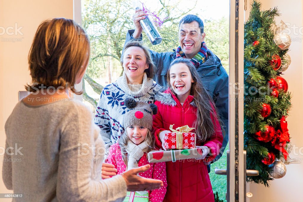 Family delivering presents at Christmas stock photo