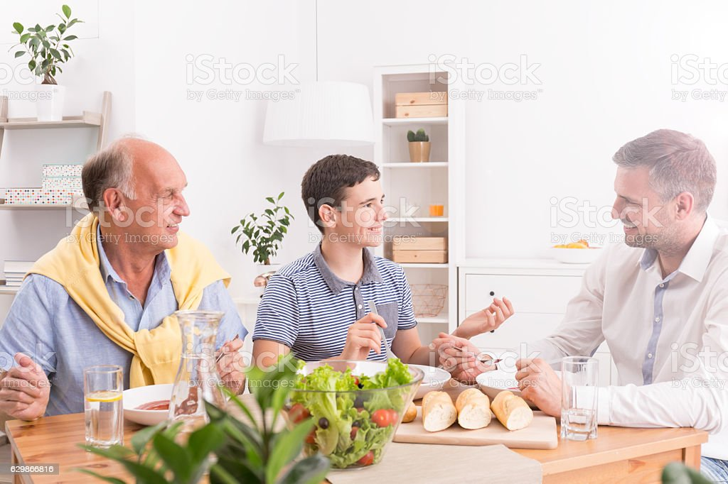 Family dinner with father stock photo