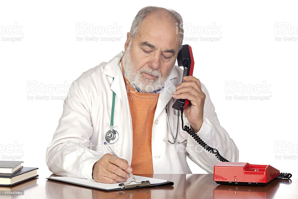 Family doctor talking on the phone stock photo