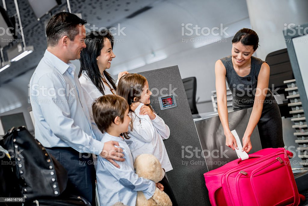 Family doing check-in stock photo
