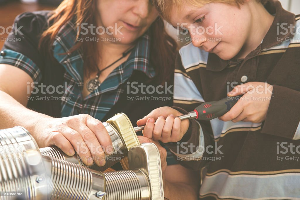 Family Doing Crafts With Recycled materials stock photo