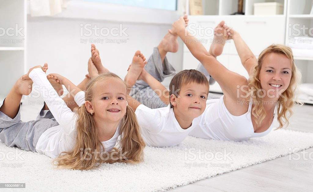Family doing stretching exercises at home royalty-free stock photo