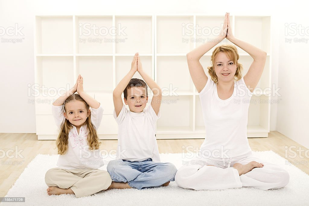 Family doing yoga exercises royalty-free stock photo