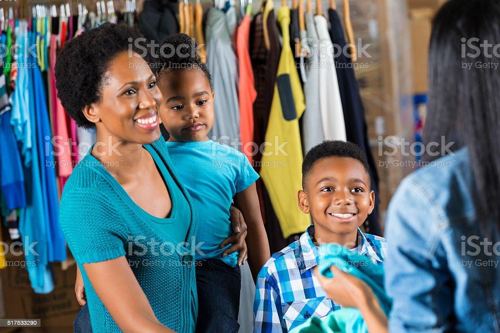 Family donates items to clothing drive stock photo