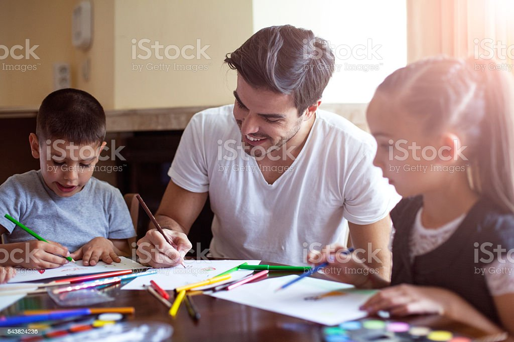 Family drawing together stock photo