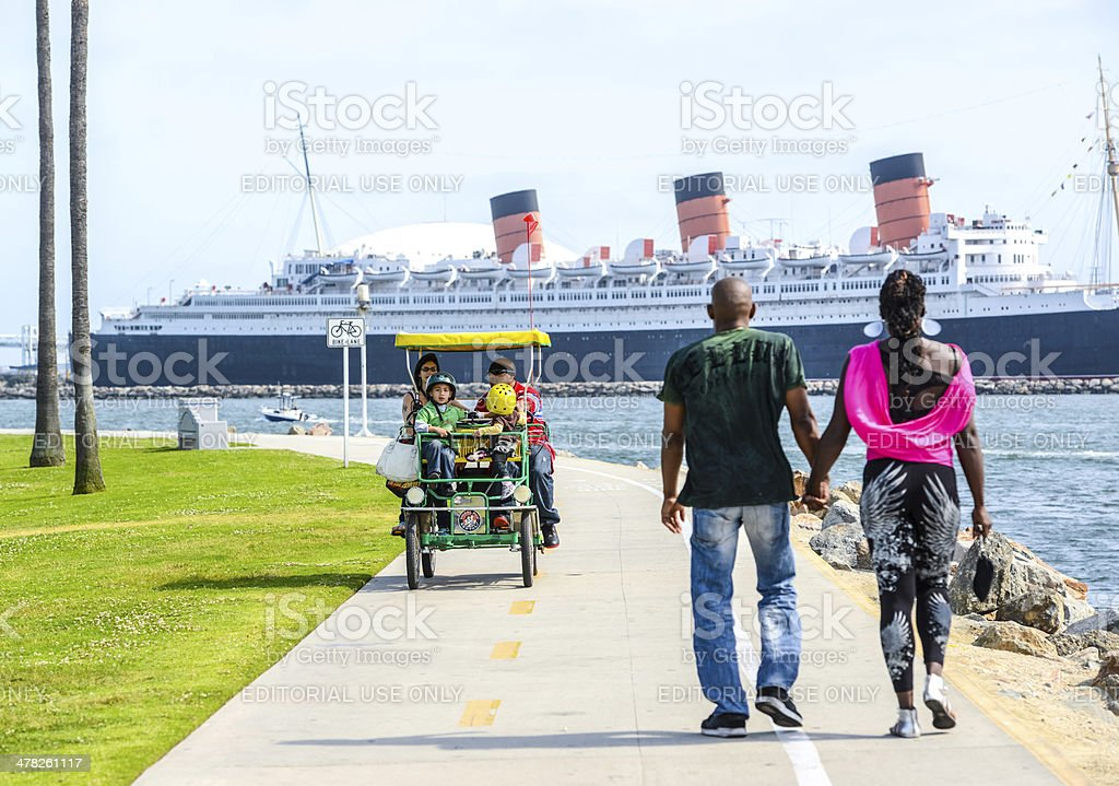 Family driving funny cart in Long Beach, California, USA stock photo