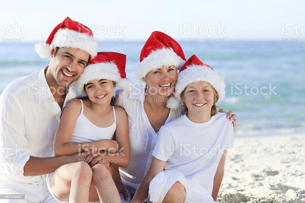 Family during Christmas day at the beach royalty-free stock photo