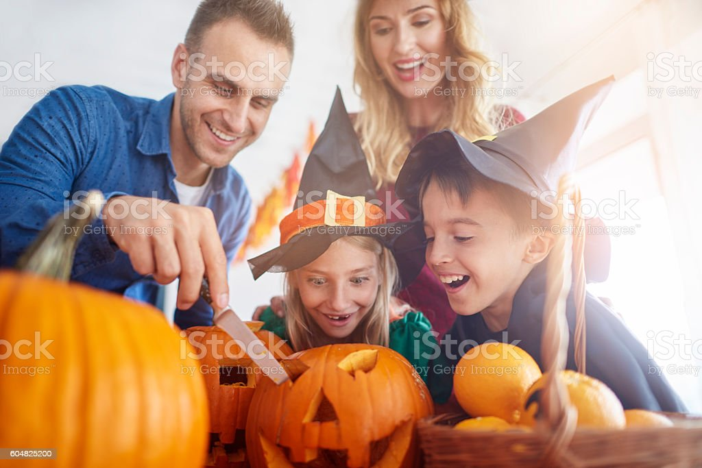Family during the Halloween preparation stock photo