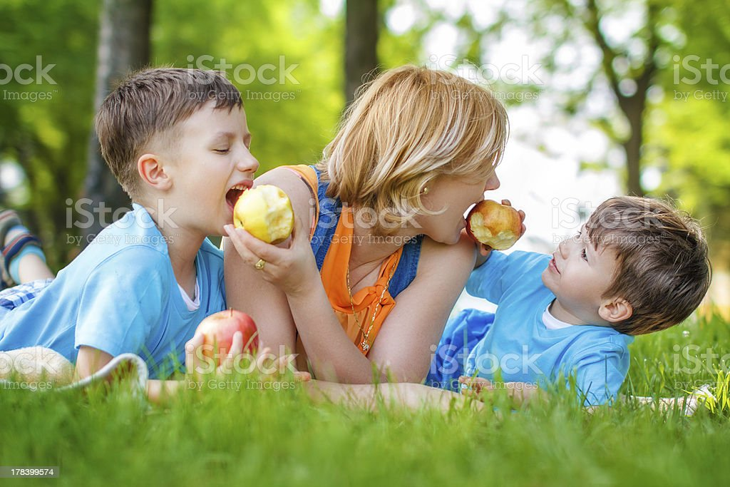 Family eating apple in the nature royalty-free stock photo