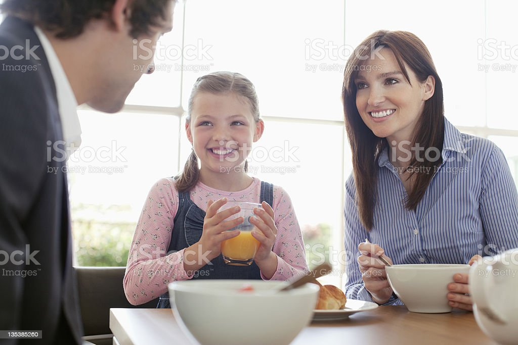 Family eating breakfast together royalty-free stock photo