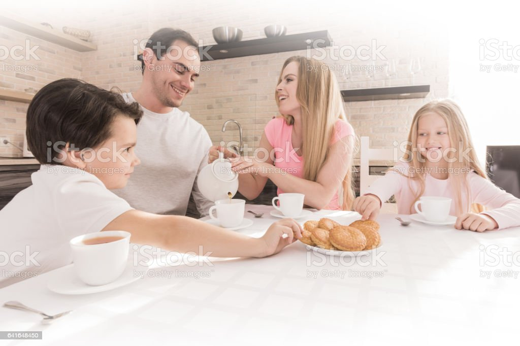 Family eating cookies stock photo