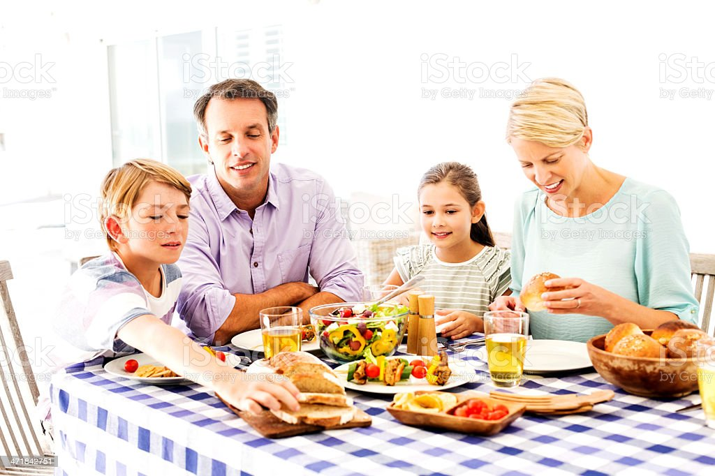 Family Eating Lunch Outside On Patio royalty-free stock photo