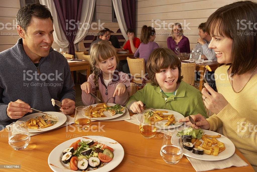 Family Eating Lunch Together In Restaurant royalty-free stock photo
