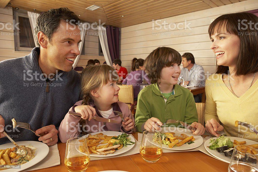 Family Eating Lunch Together In Restaurant stock photo