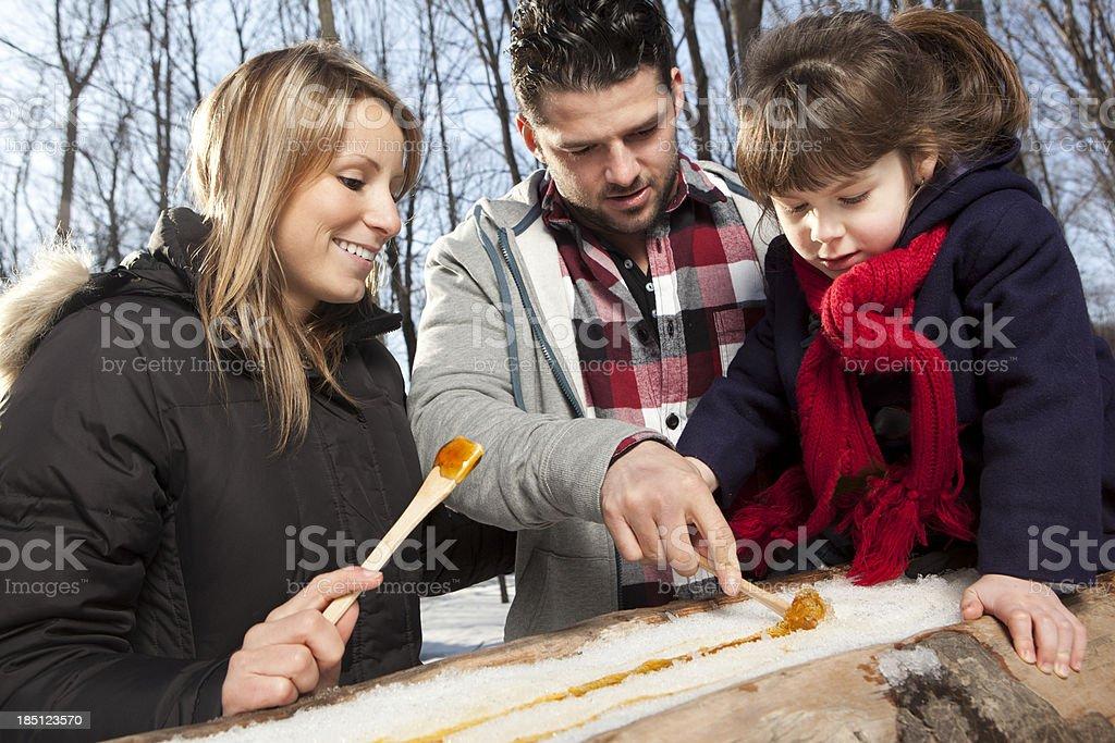 Family eating maple taffy stock photo