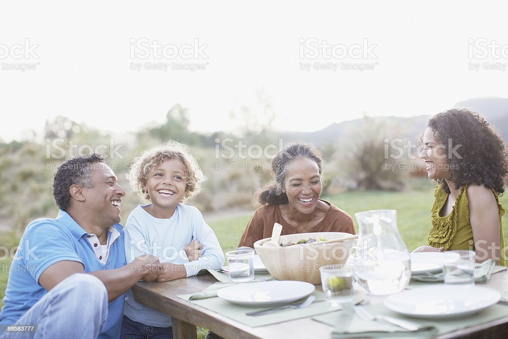 Family eating outdoors stock photo