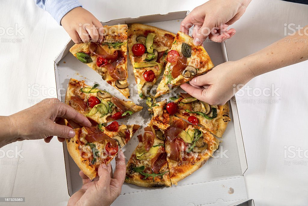 Family eating pizza royalty-free stock photo