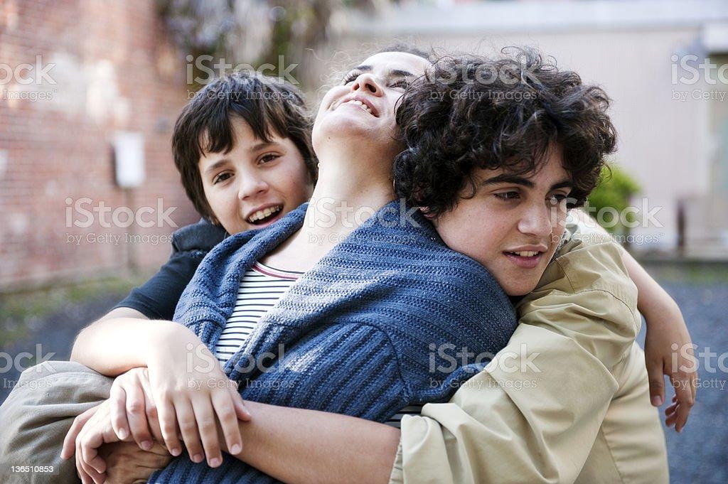Family embracing stock photo