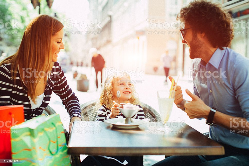 Family Enjoy Outdoors in A Cafe. stock photo
