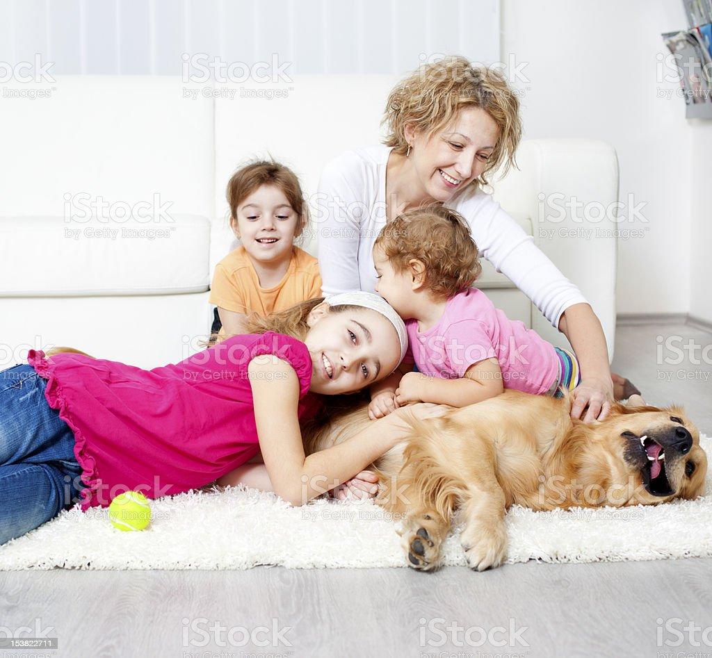 Family enjoy with Retriever at home. royalty-free stock photo